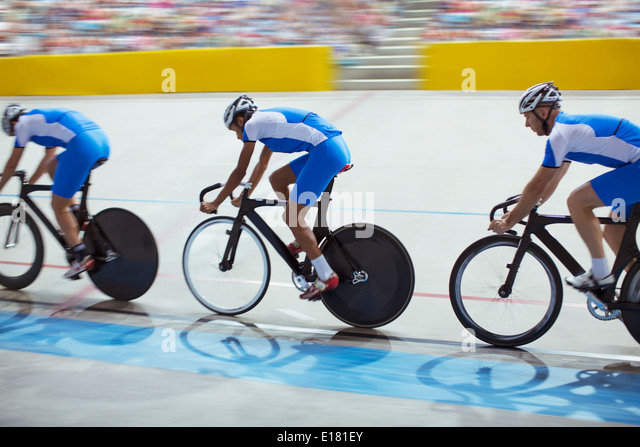 Track cycling team riding in velodrome - Stock-Bilder