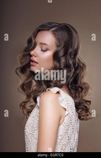 Studio Portrait of Young Dreamy Brunette with Closed Eyes - Stock Image