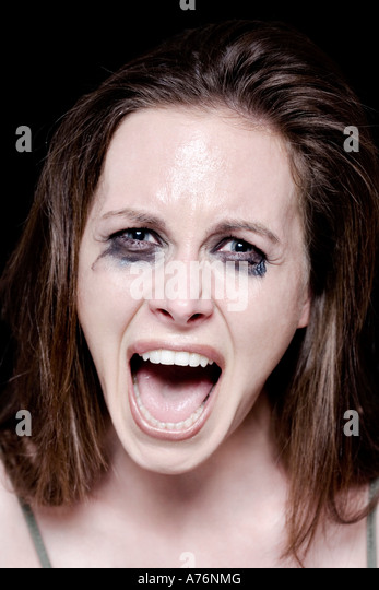 Young woman crying, portrait - Stock Image