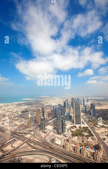 View over skyscrapers and roads in Dubai city - Stock Image