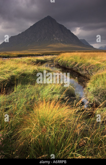 Stormy skies over Buachille Etive Mor in the Scottish Highlands - Stock Image