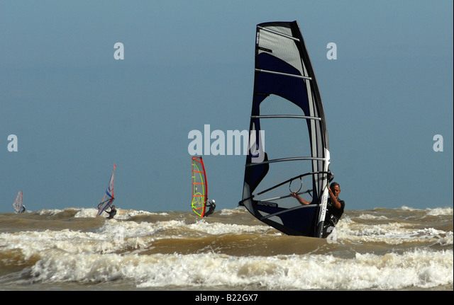 Wind surfing at Jury's Gap in East Sussex - Stock Image