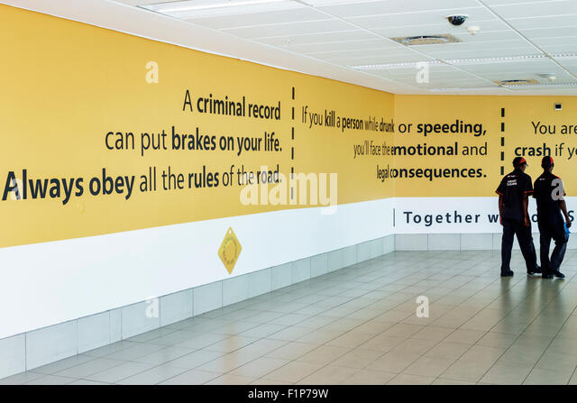 Cape Town South Africa African International Airport CPT terminal concourse gate area inside message obey laws driving - Stock Image