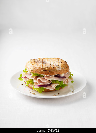 Ham and onion on plate - Stock Image