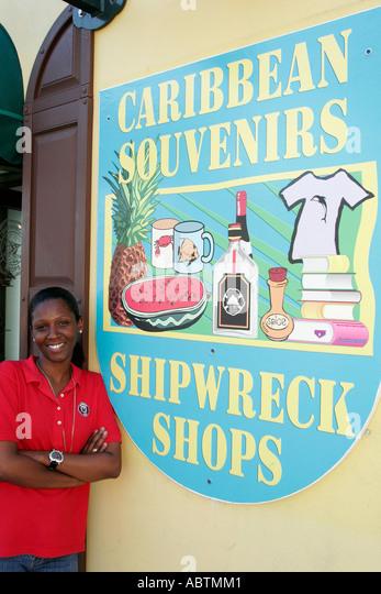 Sint Maarten Philipsburg Dutch duty free shopping souvenirs Black female sign Shipwreck Shops - Stock Image