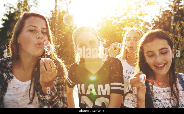 Clsoeup of group of teenagers outside on a summer day - Stock-Bilder