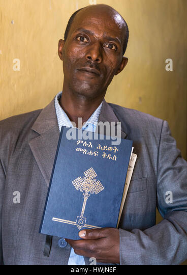 Evangelist pastor Zaid who converted from islam to christianity holding a bible, Addis Ababa region, Addis Ababa, - Stock-Bilder