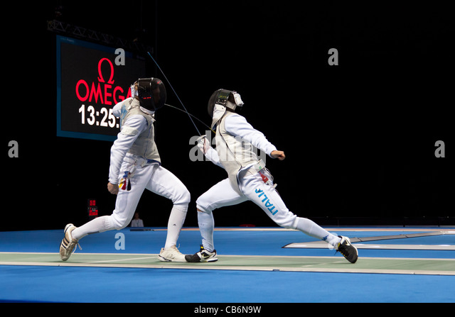 Final of the team foil fencing at the Olympic test event, London's ExCeL arena. Won by Team GB. - Stock Image