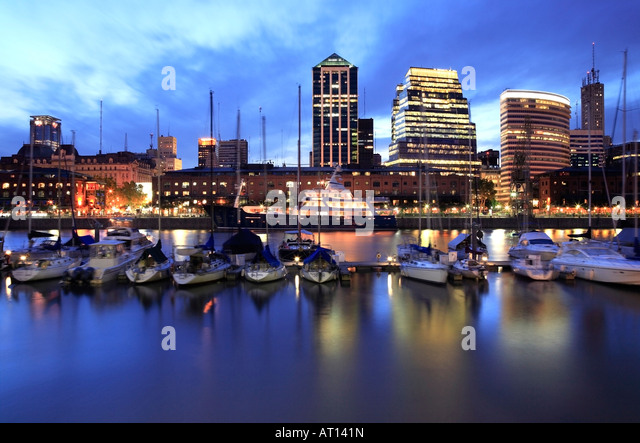 Front view of Puerto Madero yacht  club view at dusk with water reflections and lights,Buenos Aires, Argentina - Stock Image