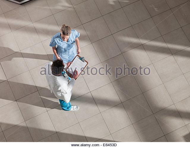 Doctor and nurse talking in cafeteria - Stock Image