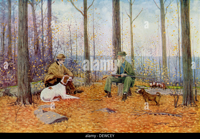 Young and old sportsmen with their bird dogs in the fall woods, circa 1900. - Stock Image