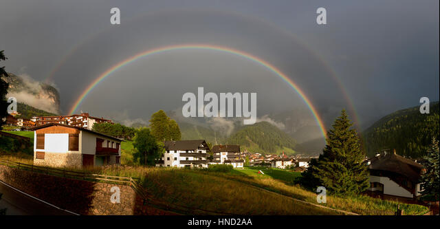 Double rainbow over the village of Selva di Val Gardena in summer season, Trentino-Alto Adige - Dolomites - Stock Image