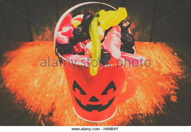 Orange halloween object photo on a sinister Jack-o-lantern head with evil smile. Retro trick or treat pumpkin head - Stock Image