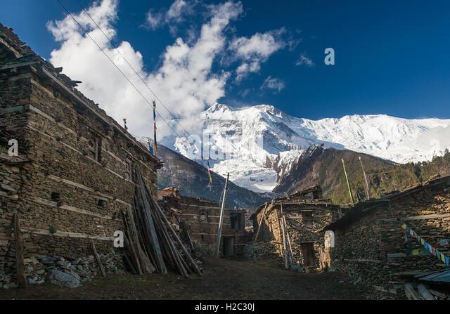 Photo Tracking Himallaya Vilage.View Snow Nepal Mountans Background. Hikking Sport Travel. Horizontal - Stock Image