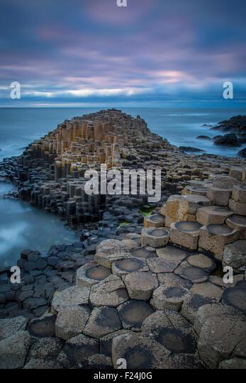 Twilight over the Giant's Causeway along the northern coast, County Antrim, Northern Ireland, UK - Stock-Bilder