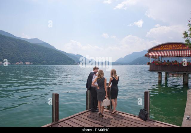 Man, woman, Lake Lugano, Morcote, work, job, occupation, profession, occupations, professions, group, drinking, - Stock Image