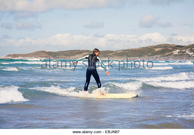 Boy surfing - Stock Image