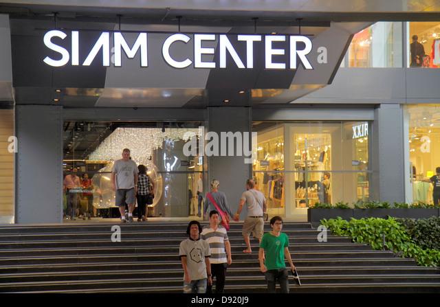 Bangkok Thailand Pathum Wan Rama 1 Road Siam Center centre Discovery complex mall shopping entrance Asian man - Stock Image