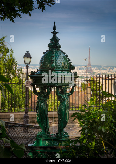 Beautiful public drinking fountain on the Montmartre butte in central Paris, France - Stock Image