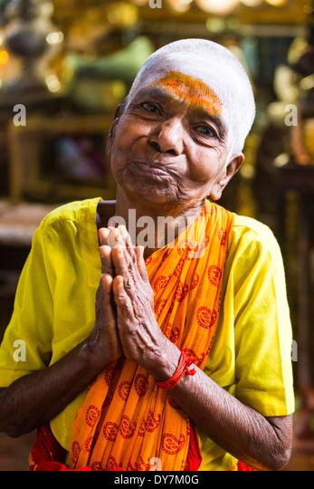 Devotee in Meenakshi Amman Temple, Madurai, India - Stock Image