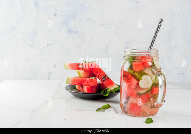 Summer drinks and cocktails. Lemonade, infused detox water with mints, fresh watermelon and cucumber. In mason jar, - Stock Image