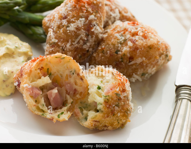 Ham and Cheese Beignets with Asparagus and Dijonnaise - Stock Image