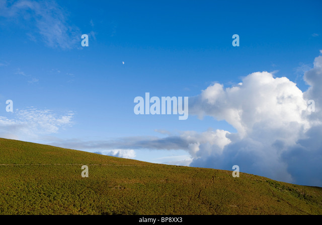 Moon over hill full of heather, near Rabacal, Paul da Serra Plateau, Madeira, Portugal - Stock Image