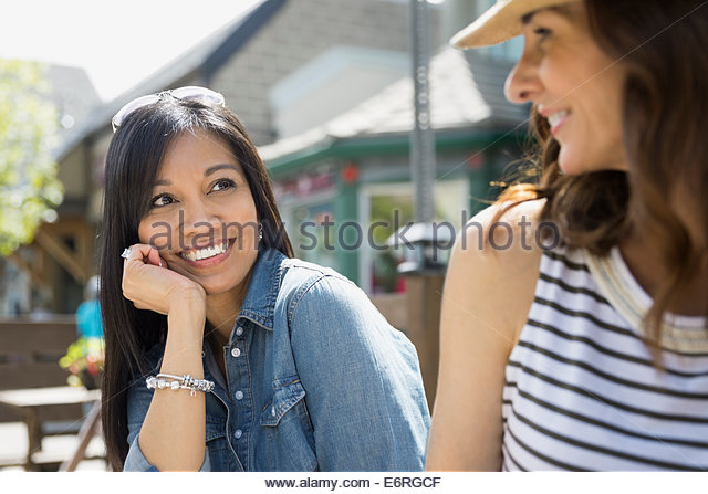 Women sitting together in cafe - Stock Image