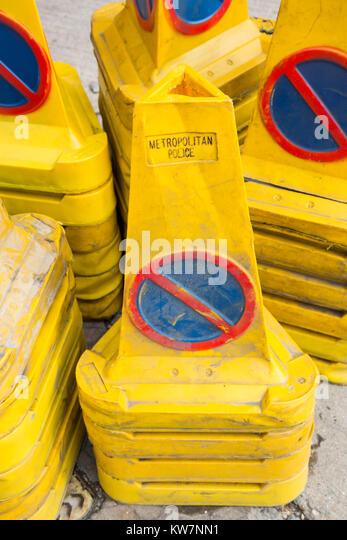 Yellow no parking traffic cones belonging to the Metropolitan Police, London, England, United Kingdom - Stock Image
