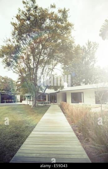 Wooden walkway of modern backyard - Stock Image