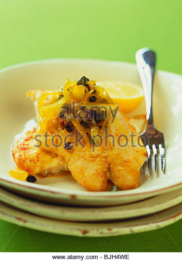 Fish fillet with sweet and sour onions - Stock Image