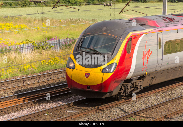 Virgin trains high speed Pendolino at Winwick junction on the West Coast main line. WCML. - Stock Image