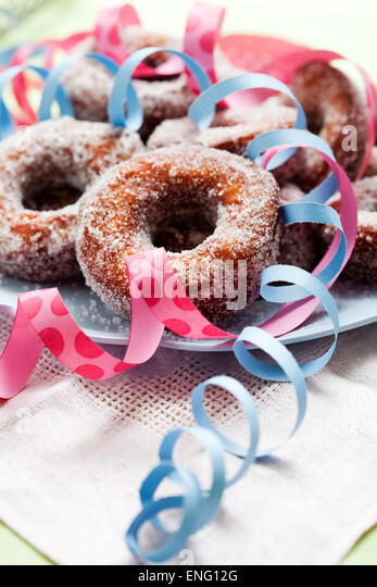 Finnish traditional Vappu food, sugar donuts with sima - Stock Image