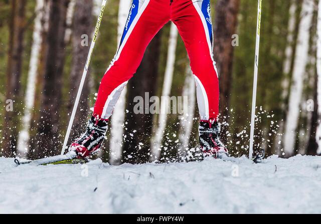 Kyshtym, Russia -  March 26, 2016: closeup foot male skier sprays snow from under ski during Championship cross - Stock-Bilder