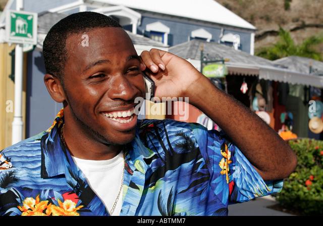 Sint Maarten Philipsburg Dutch Black male cell phone - Stock Image