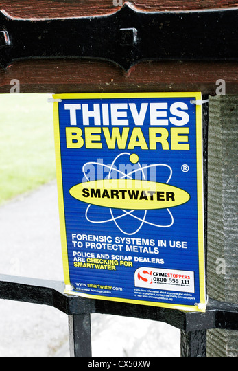 A sign warning potential thieves of the use of Smartwater, a forensic protection system for metals. - Stock Image