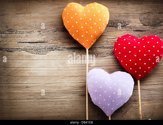 Valentines Vintage Handmade Hearts over Wooden Background - Stock Image