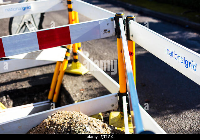 National grid road works Streetworks digging up roads gas pipes pipelines barriers - Stock Image