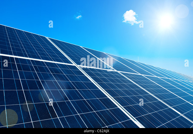 Solar Panel with Sun and Lens Flares and blue Sky - Stock Image