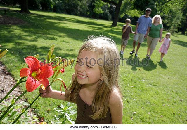 Indiana Valparaiso Ogden Gardens botanical flower garden day lilly flora horticulrue bloom man woman boy girl parent - Stock Image