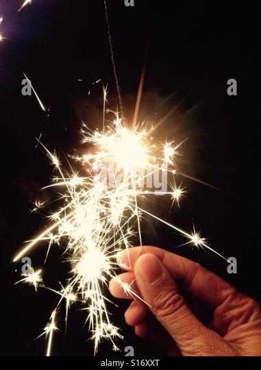 Holding a sparkler - Stock-Bilder