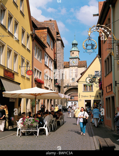 Old Town Germany Europe half-timbered houses lives people Marcus tower Rothenburg street cafe - Stock Image