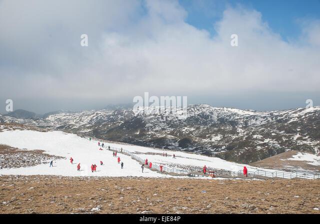 Many tourist playing snow in Valley of the Blue Moon in Shangri-La, Yunnan Province, China. - Stock Image