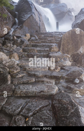 Wapama Falls Flows Over Trail after a heavy snow year - Stock Image