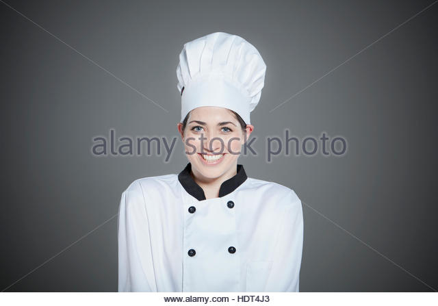 Portrait of smiling young chef. - Stock Image