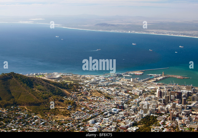 Cape Town harbour and skyline, as seen from Table Mountain. The under-constructionGreen Point Stadium can be seen - Stock Image
