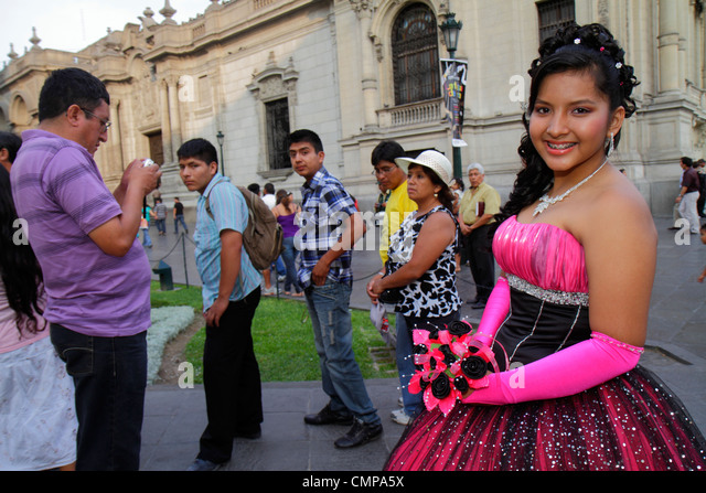 Lima Peru Plaza de Armas public square park teen Quinceañera quince Hispanic girl man woman boy gown formal - Stock Image