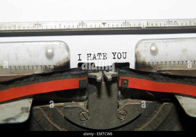 Sheet of paper with the inscription ' I hate you'  in the typewriter - Stock Image