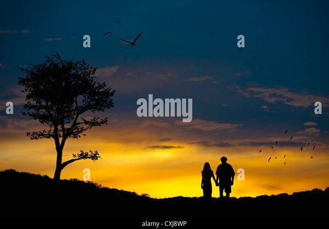 Couple in love at romantic landscape - Stock-Bilder