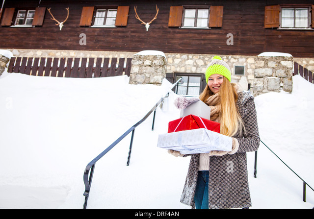 Young Woman With Christmas Presents, Spitzingsee, Bavaria, Germany - Stock-Bilder